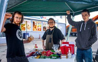 Comrade Shibby, Comrade Ruadhan and Comrade Soviet posing at free food table service