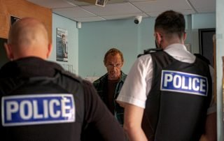 Marc Horn explaining to two police constables why he is issuing the caution
